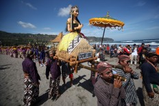 The Dewi Sri statue, which villagers believe is the goddess of rice, is also floated to the sea. JP/Boy T. Harjanto