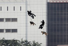 Personnel of the Army's Special Forces (Kopassus), accompanied by sniffer dogs, rappel from a helicopter during a mock terror attack in Jakarta on Wednesday, July 25, 2018. With the involvement of military and police personnel, the training was held by the National Counterterrorism Agency (BNPT) as part of security preparations for the upcoming Asian Games. JP/Dhoni Setiawan