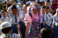 Back to school: Students of Al Irsyad Al Islamiyyah Early Childhood School (PAUD) look enthused about returning to class after the long vacation in Jember, East Java, on Monday, July 16, 2018. JP/Wendra Ajistyatama