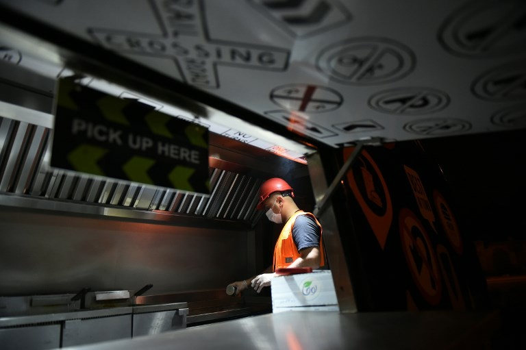 Burger on wheels: Saudis try once 'lowly' jobs as economy bites
