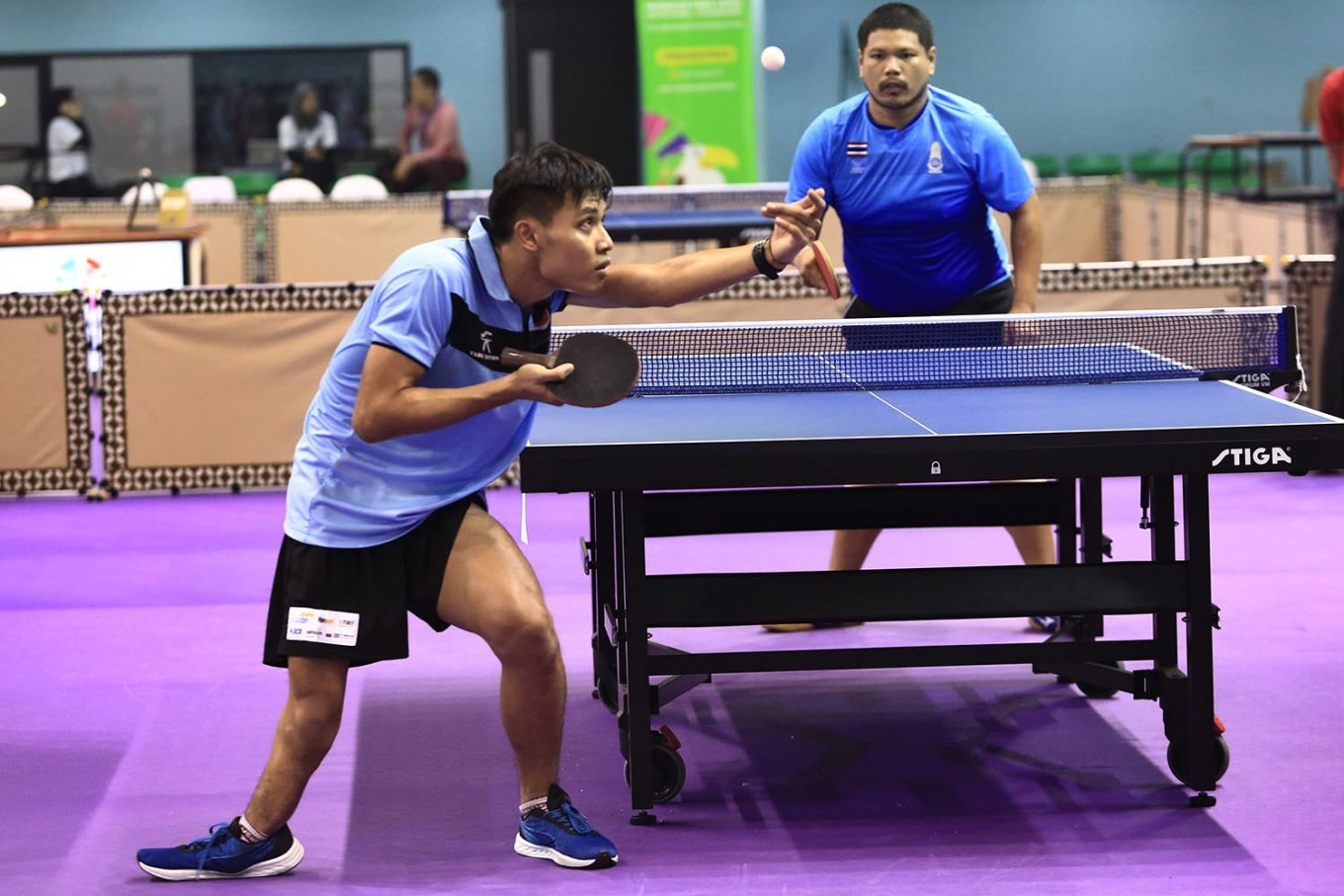 Games for all: Indonesian table tennis player Banyu Tri (left) serves against Thailand's Wangphonphathanasi in the Men's Team TT8 Indonesia Para Games Invitation Tournament in Jakarta on Tuesday, July 3, 2018. JP/Dhoni Setiawan