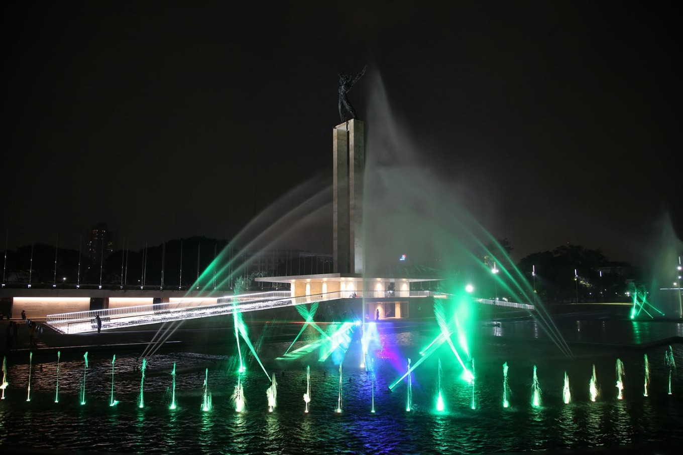 Revivified: An illuminated fountain with the Irian Jaya Liberation Statue in the background is seen at the renovated Lapangan Banteng in Jakarta. The square was inaugurated by Governor Anies Baswedan on Wednesday, July 25, 2018. JP/PJ Leo