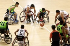 Indonesia (white jerseys) plays against Malaysia at the Indonesia Para Games Invitational Tournament at Gelora Bung Karno sporting complex in Senayan, Jakarta, on Sunday, July 1, 2018. Indonesia won 54-53. JP/Dhoni Setiawan