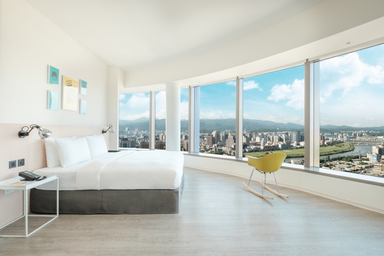 A loft king room with a view of a river at amba Songshan hotel.