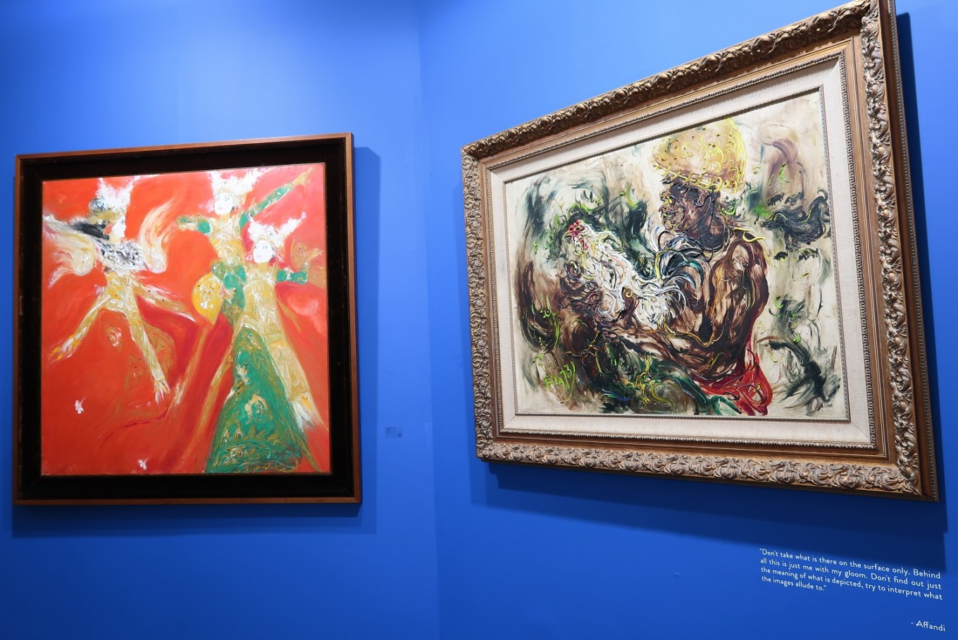 "Left to right: ""Spirit Legong"" by Srihadi Soedarsono and ""Man with Cockerel"" by Affandi are seen at 2018 Art Jakarta."