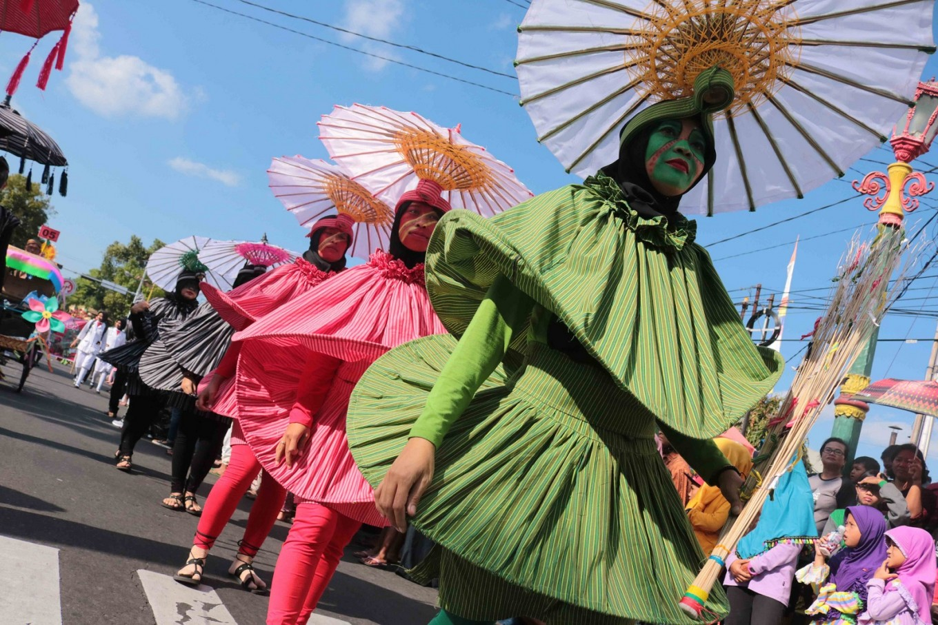 Hundreds of participants take part in the Klaten Lurik Carnival on Jl.  Pemuda, Klaten, Central Java, on July 28. Participants showcased unique costumes made out of 'lurik' fabrics.