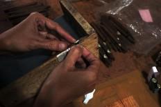 A trademark is put on every cigar produced by PD Taru Martani. JP/Magnus Hendratmo