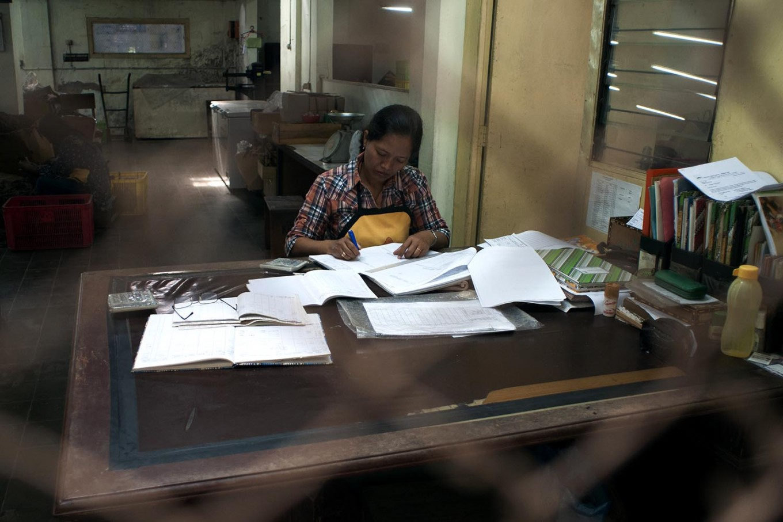 A clerk maintains records for PD Taru Martani. JP/Magnus Hendratmo