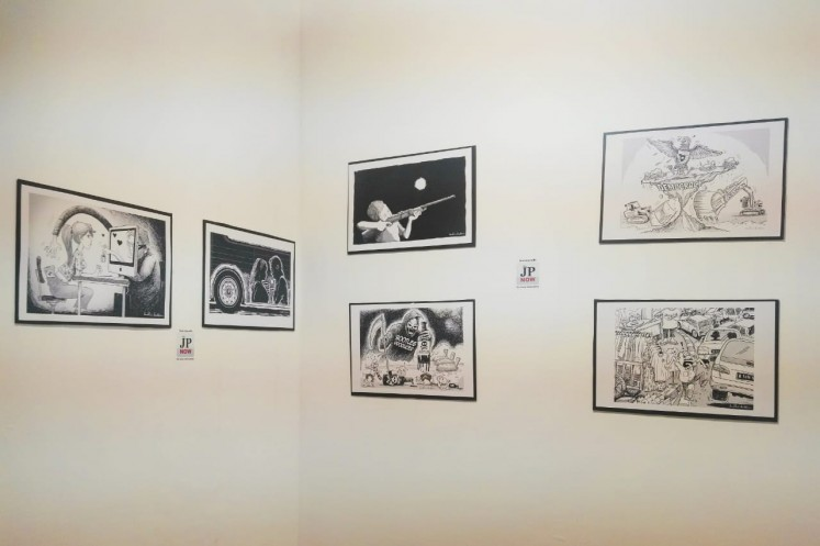 Cartoon editorials by Budhi Button at The Jakarta Post booth at Art Jakarta 2018