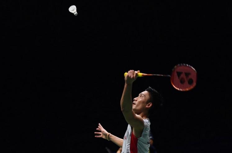 Kento Momota of Japan hits a shot against Shi Yuqi of China in the men's singles final during the badminton World Championships in Nanjing, Jiangsu province on August 5, 2018.  Johannes EISELE / AFP