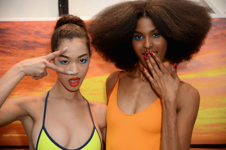 Models pose backstage for Chromat AW18 during New York Fashion Week.