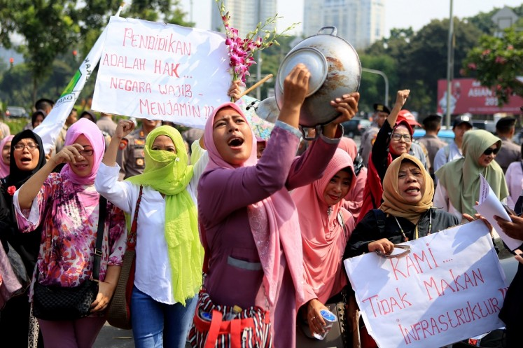 Women grouped in the Emak-Emak Militan, (militant moms) stage a rally on July 18 in at the State Palace in Central Jakarta. The women protested about economic issues, including rising prices, and criticized President Joko