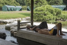 Tourists fall asleep in Korakuen Garden, Okayama. JP/Rosa Panggabean