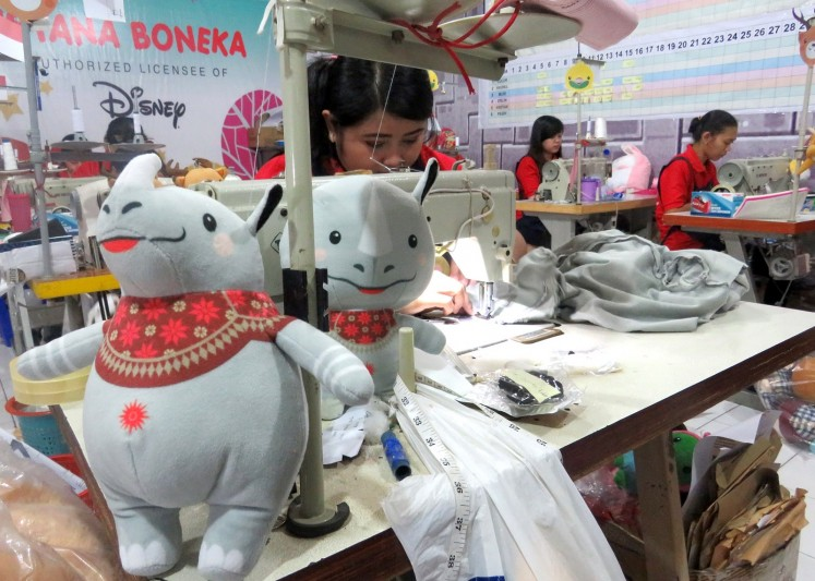 Kaka, the one-horned rhino character, one of Asian Games 2018's three mascots, is at works at the factory.