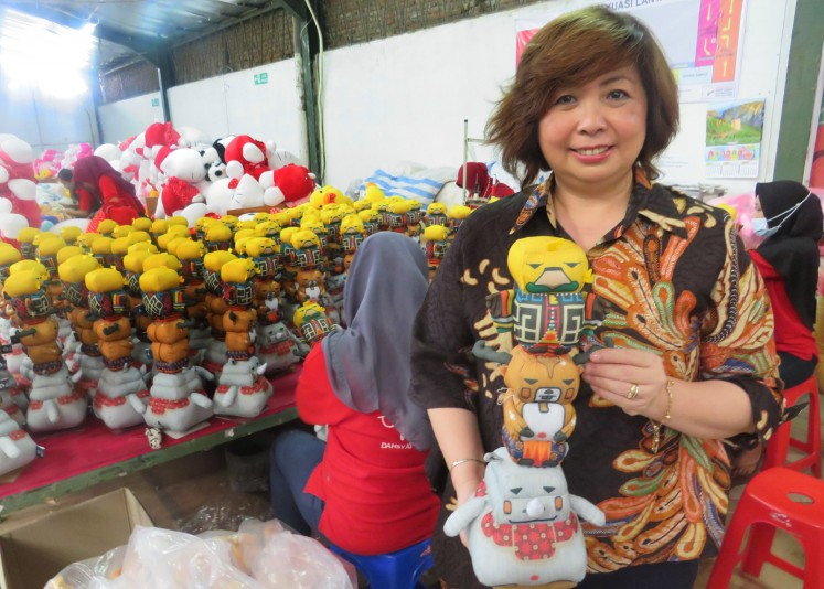 Owner of Istana Boneka, Susan Soewono, poses with mascot dolls of the 2018 Asian Games.