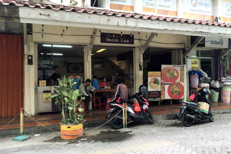 Kedai Kopi Uncle Cun offers food and drink inside Puri Indah Market.