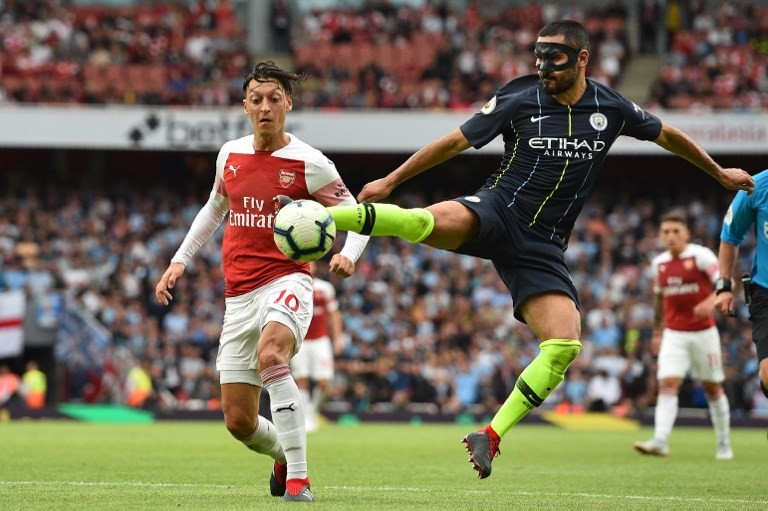 Guardiola salutes City's sacrifice as champs subdue Arsenal