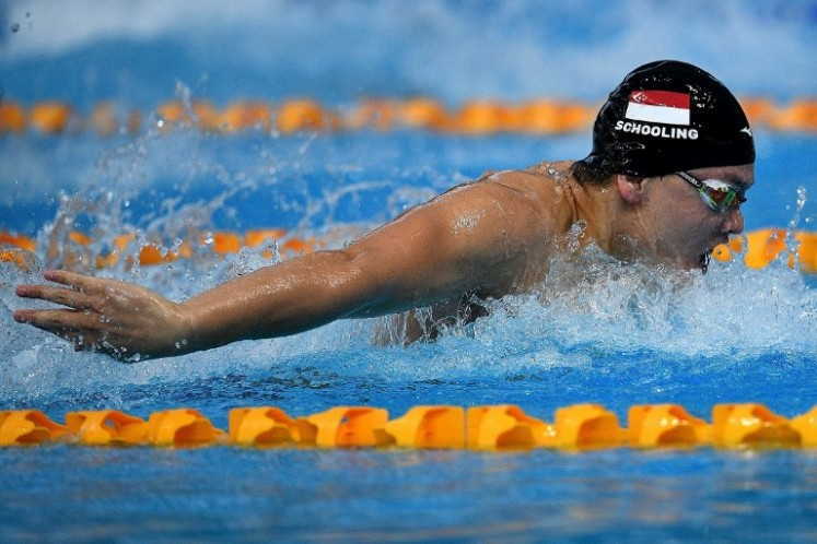 Singapore's Joseph Schooling competes in the men's swimming 100m butterfly final event of the 29th Southeast Asian Games (SEA Games) at the National Aquatics centre in Kuala Lumpur on August 23, 2017.  Manan VATSYAYANA / AFP