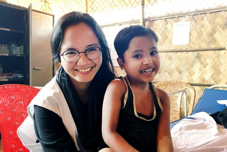 All smiles: Rangi Wirantika poses with a child during her assignment in Cox's Bazar, Bangladesh.