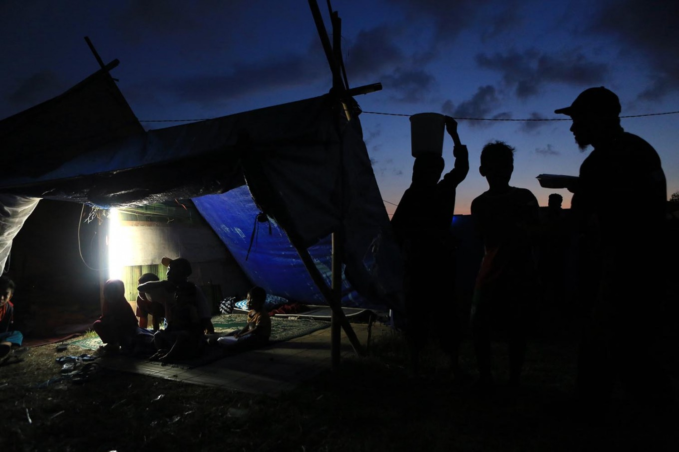 Safe place: People erect tents and try to get electricity and clean water. JP/ Seto Wardhana
