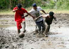 Young men fight in a mud soccer to commemorate Independence Day. JP/Boy T. Harjanto