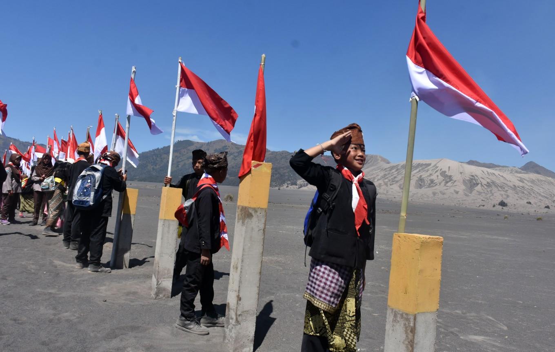 A participant salutes the national flag.