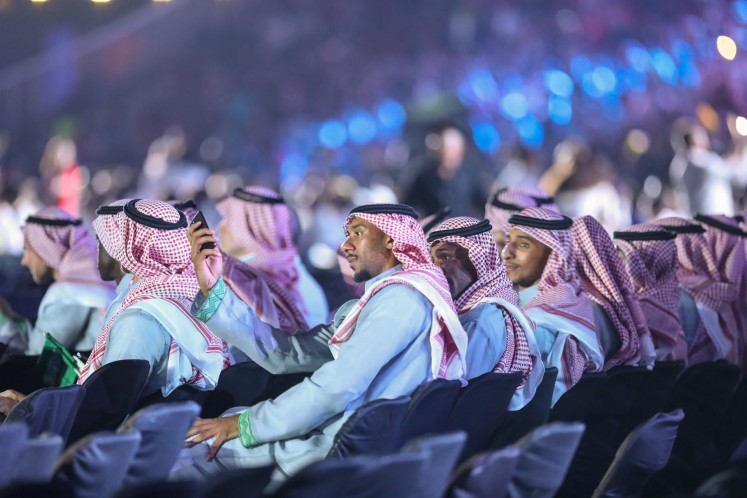 Saudi Arabian athletes watch the opening ceremony of the 18th Asian Games at Gelora Bung Karno Stadium in Jakarta on Saturday.
