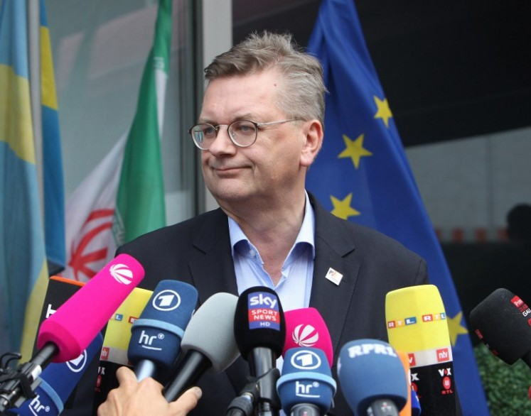 President of the German Football Association (DFB) Reinhard Grindel talks to media as he arrives at Frankfurt international airport on June 28, 2018, after flying back from Moscow following the German national football team's defeat in the Russia 2018 football World Cup. Germany's embattled national team braced for a cold homecoming on June 28, 2018 after a shock World Cup exit that has plunged the football-mad nation into mourning and leaves the future of coach Joachim Loew in the balance.