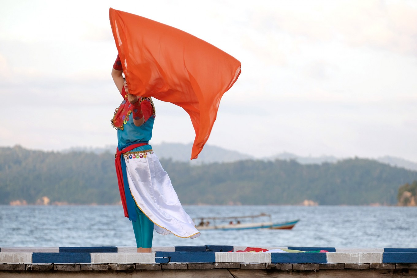 A dancer gives a contemporary touch to Tojo Una Una dance during the opening of Togean International Oceanic Festival on Papan Island.