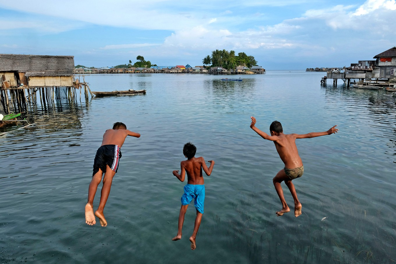 Children of the Bajo tribe play in Kabalutan village on Togean Islands in Tojo Una Una regency, Central Sulawesi.