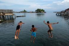 Play around: Children of Bajo tribe play in Kabalutan village on Togean Islands in Tojo Una Una regency, Central Sulawesi. JP/ Jerry Adiguna