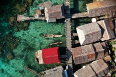 Houses by the sea: An aerial view of Bajo village, Papan Island. JP/ Jerry Adiguna