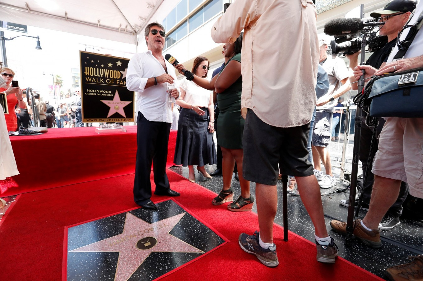 Star maker Simon Cowell gets his place on Hollywood Walk of Fame