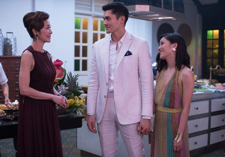 A still from 'Crazy Rich Asians' starring Michelle Yeoh (Eleanor, left), Henry Golding (Nick Young, middle) and Rachel Chu (Constance Wu, right).