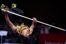 Upside down: Myanmar wushu athlete Thein Than flips during the 2018 Asian Games men's nangun wushu competition. JP/ PJ Leo