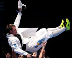 On top: Dmitriy Alexanin of Kazakhstan celebrates with his team after winning the men's individual epee fencing match against Park Sang-young from Korea.JP/ PJ Leo