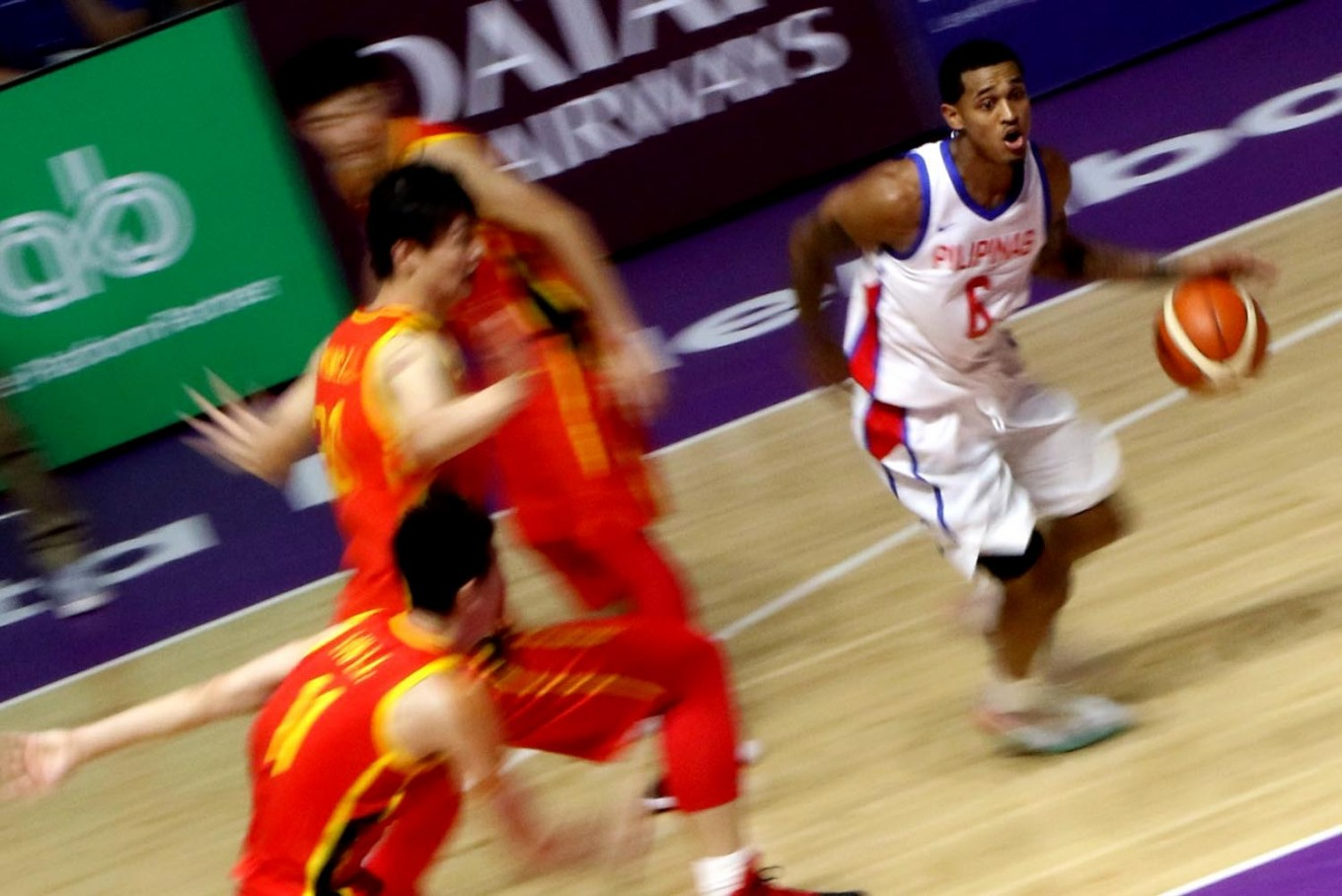 Drive through: Philippines' Jorda Clarkson (right) controls the ball during a basketball game against China. JP/ Seto Wardhana