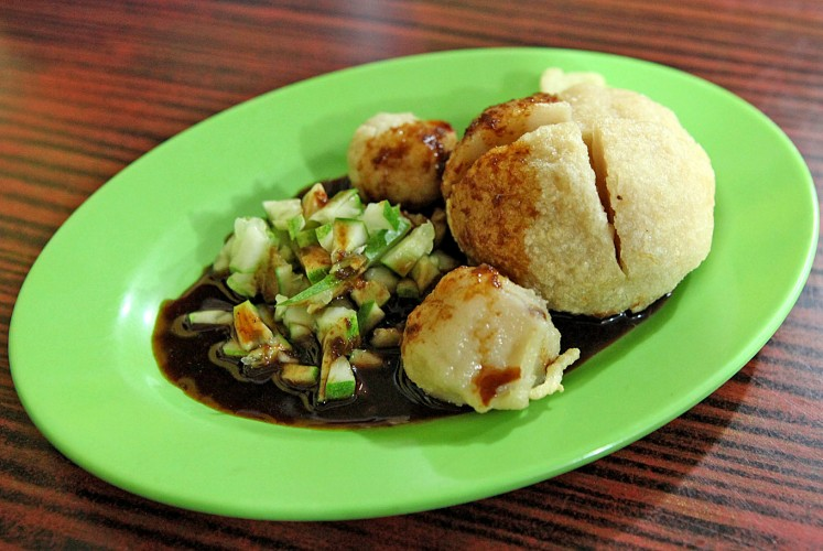 Take a bite: Never leave Palembang without tasting the city's best-known traditional dish, pempek (fishcake with vinegar and soy sauce).