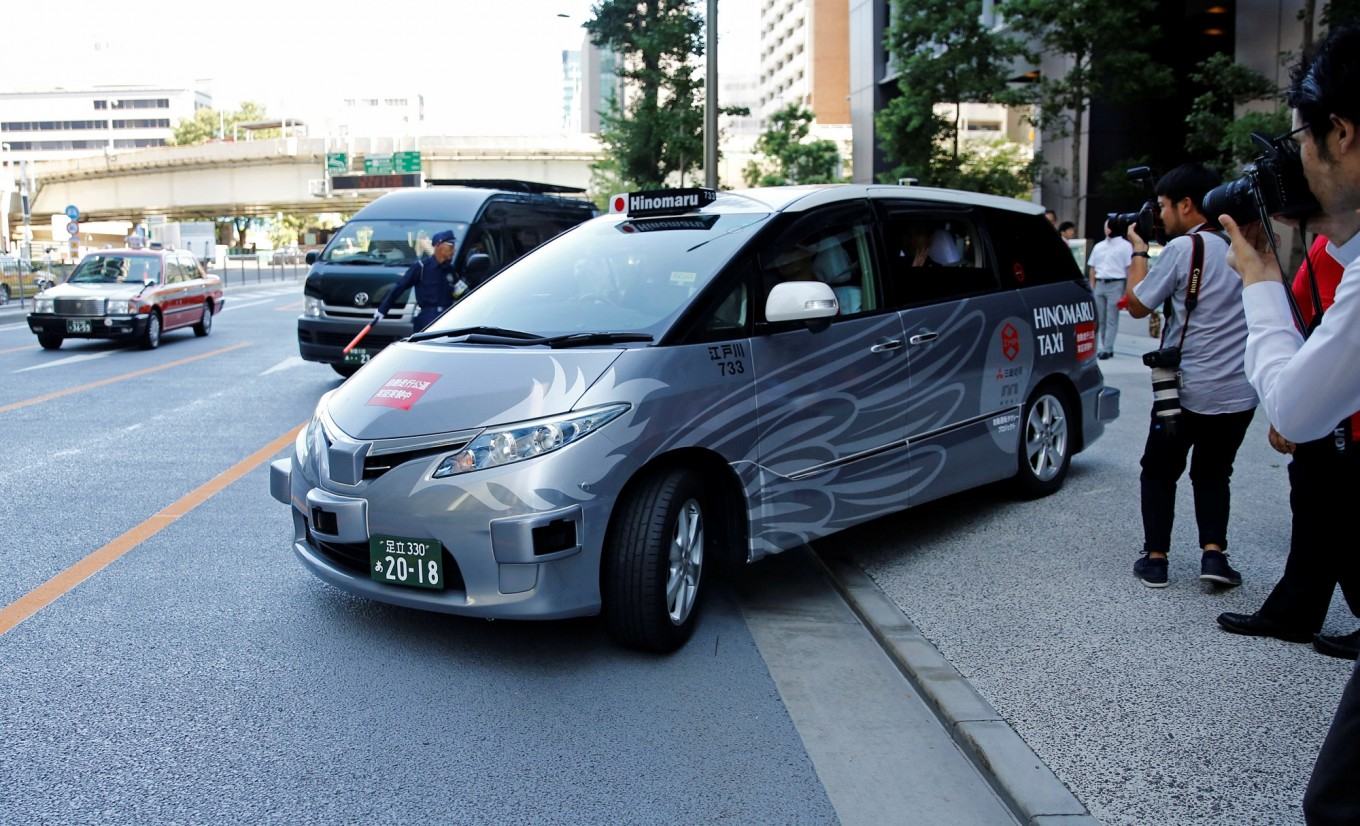 Autonomous taxi trial carrying passengers begins in Tokyo