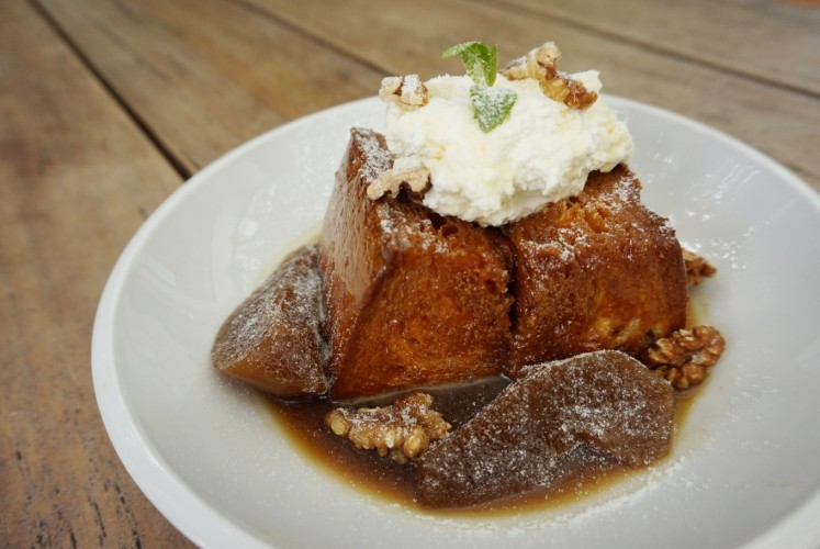 Beau's poached pear French toast, consisting of caramelized brioche and poached pear.