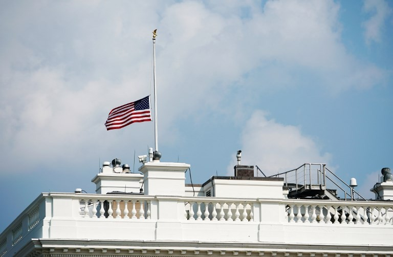 Trump, under pressure to honor McCain, orders flags to half-staff