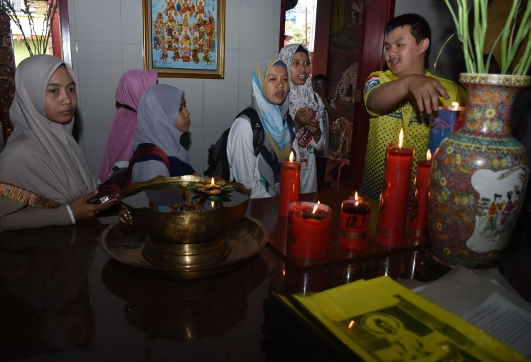Peace Train participants visit the Kwan Im Tong temple in Batu, East Java.