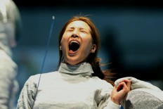 Elation: South Korea fencer Choi Soo-Yeon screams during the women's saber team semifinal match between South Korea and Japan at the 2018 Asian Games. South Korea won 45-25. JP/Seto Wardhana
