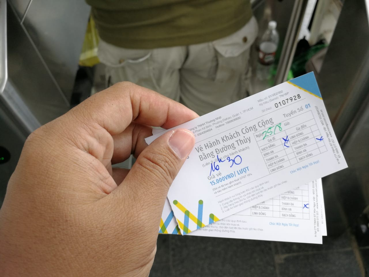 A tourist holds Saigon water bus tickets.