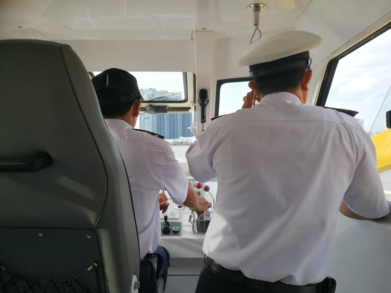 Crew members of the Saigon water bus comandeer the boat.