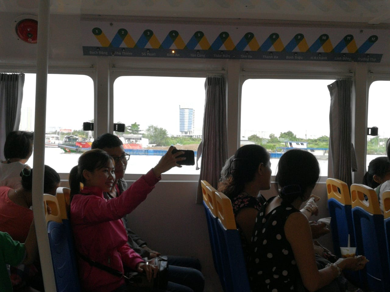 A couple takes a wefie aboard the Saigon water bus.