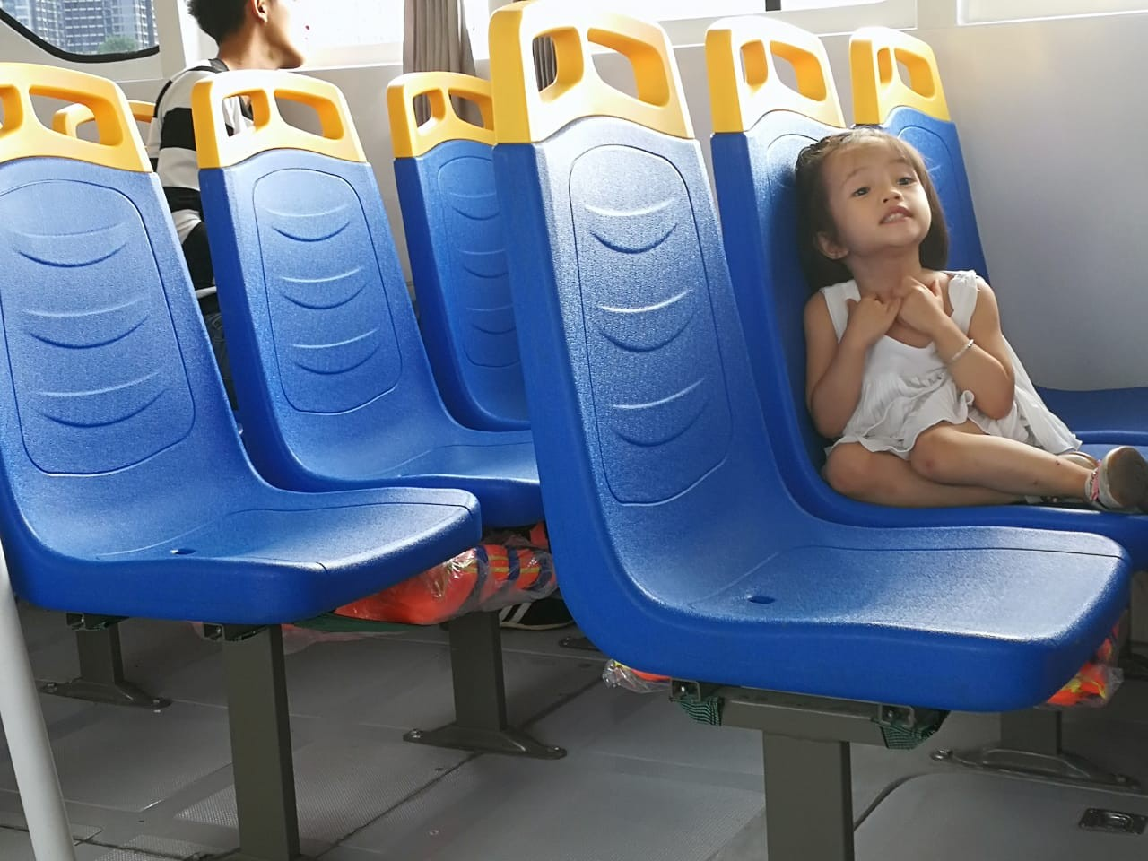 A young tourist enjoys 'me time' aboard the Saigon water bus.