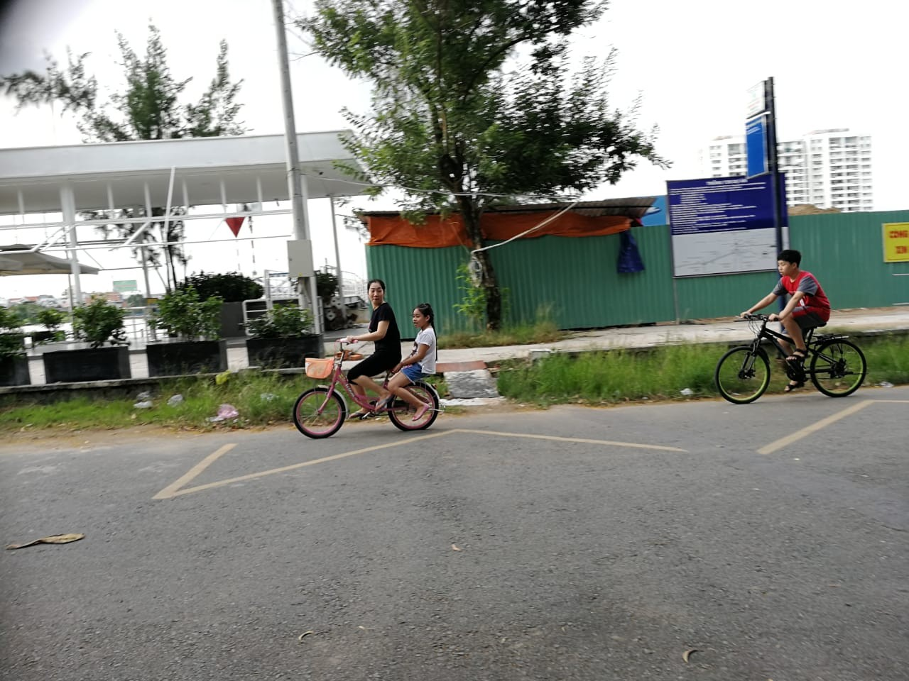 Residents cycle past the Thanh Da water bus station.