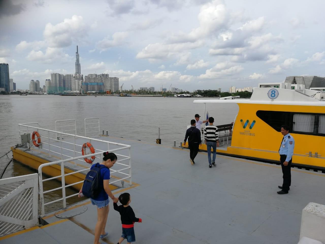 Passengers embark the Saigon water bus at Bach Dang Station.