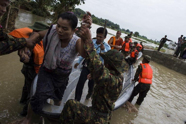 Rescuers struggle to reach stranded in Myanmar dam flooding